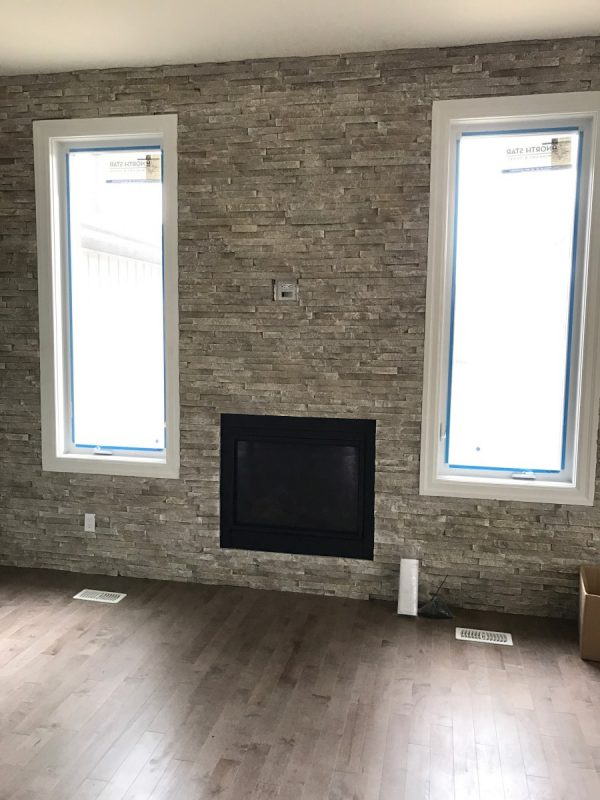 Brick feature wall with fireplace